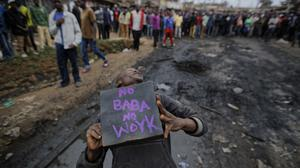 A supporter of Kenyan opposition leader Raila Odinga during demonstrations in the Kawangware slum of Nairobi (AP Photo/Ben Curtis)