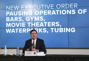 Mr Ducey also announced bars, nightclubs and water parks must close again for at least a month (Michael Chow/The Arizona Republic via AP, Pool)