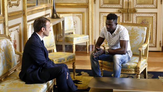 French President Emmanuel Macron meets Mamoudou Gassama at the Elysee Palace in Paris (Thibault Camus/AP)