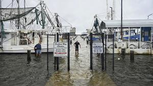 Fishermen secure their boats on the Mississippi Gulf Coast (Lukas Flippo/The Sun Herald via AP)
