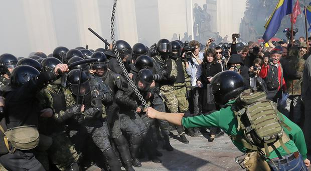 Police clash with demonstrators outside parliament in Kiev, Ukraine (AP)