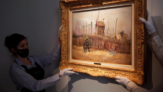 Sotheby's personnel display the painting by Vincent van Gogh (Christophe Ena)