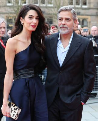 George and Amal Clooney (Andrew Milligan/PA)
