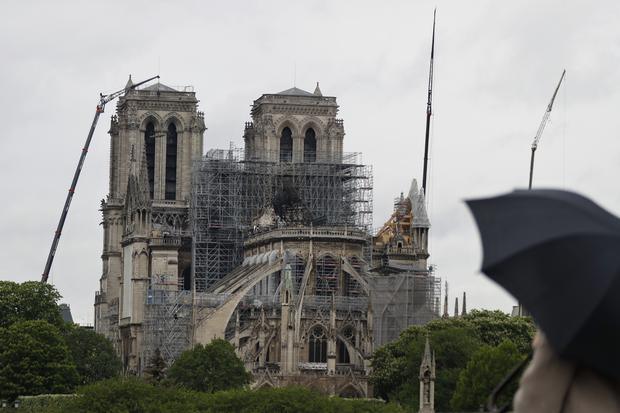Notre Dame Cathedral was badly damaged in a fire (Thibault Camus/AP)