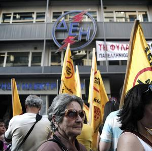 Protesters take part in a rally organized by Public Power Corporation workers in central Athens
