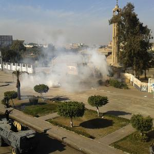 Egyptian security forces fire tear gas to disperse supporters of ousted President Mohammed Morsi as they protest at Al-Azhar University in Cairo (AP)