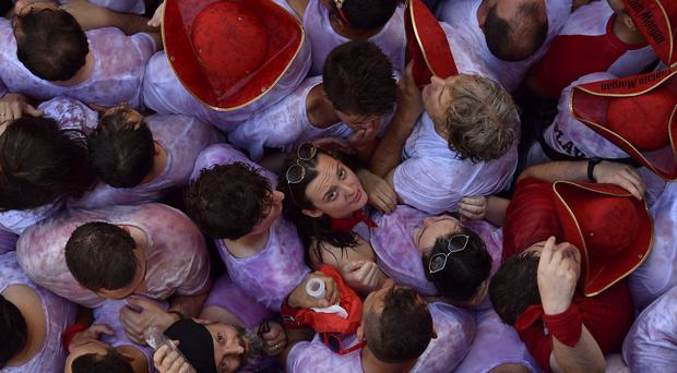 Revellers packed the main square in Pamplona during the launch of the traditional 'Chupinazo' rocket (Alvaro Barrientos/AP)