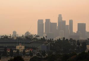Downtown Los Angeles and Dodger Stadium are shrouded in smoke from the Bobcat and the El Dorado fires (Keith Birmingham/The Orange County Register/AP)