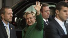 Hillary Clinton waves as she arrives for a meeting with Israeli leader Benjamin Netanyahu in New York (AP)