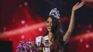 Catriona Gray of the Philippines waves to the audience after being crowned the new Miss Universe 2018 (AP)