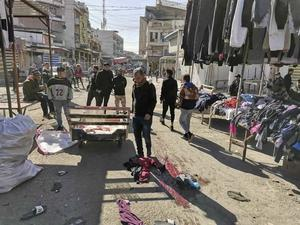 The site of a deadly bomb attack in Baghdad's bustling commercial area (Hadi Mizban/AP)