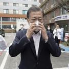 South Korean President Moon Jae-in, center, wears a mask to inspect the National Medical Center in Seoul, South Korea amid the outbreak of the new coronavirus (South Korea Presidential Blue House/Yonhap via AP)