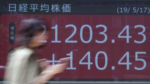 Stock markets bounced back after the US government announced the grace period (AP Photo/Eugene Hoshiko)
