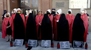 Campaigners in Poland with obituaries of women who fell victim to domestic violence (AP/Czarek Sokolowski)