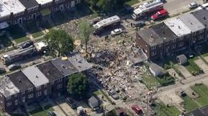 The explosion levelled several homes (WJLA-TV via AP)