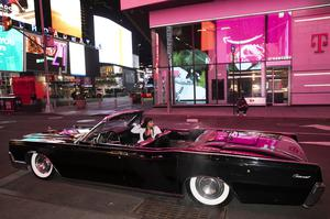 Tina Singh relaxes in a friend's 1967 Lincoln Continental in New York's Times Square (Mark Lennihan/AP)
