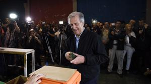 Tabare Vazquez arrives in the polling station to cast his vote. (AP)