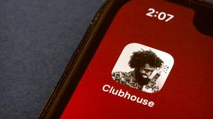 The icon for the social media app Clubhouse is seen on a smartphone screen in Beijing (Mark Schiefelbein/AP)