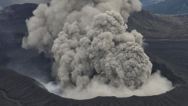 Volcanic smoke billows from Mount Aso as it blasts out chunks of magma in the first eruption in 22 years (AP/Kyodo News)
