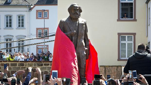 A bronze statue of Karl Marx is unveiled in Trier, Germany (Michael Probst/AP)