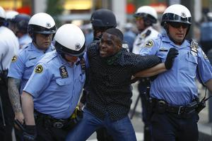Philadelphia police restrain a man during the Justice for George Floyd Philadelphia Protest on Saturday (Matt Rourke/AP)