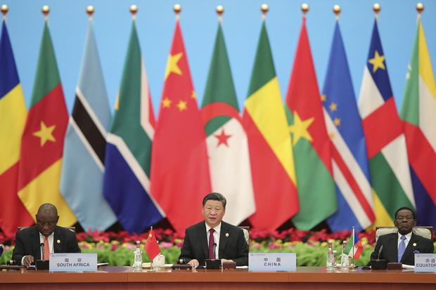Chinese President Xi Jinping (centre) has said unification with Taiwan cannot be delayed indefinitely (Lintao Zhang/AP)