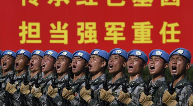 Soldiers practice marching in formation ahead of the military parade to celebrate the 70th anniversary of the founding of the People's Republic of China (Naochiko Hatta/AP)
