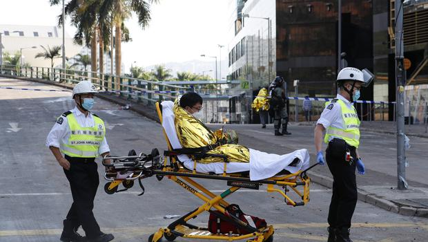 A protester on a stretcher leaves the campus of Hong Kong Polytechnic University (Vincent Thian/AP)