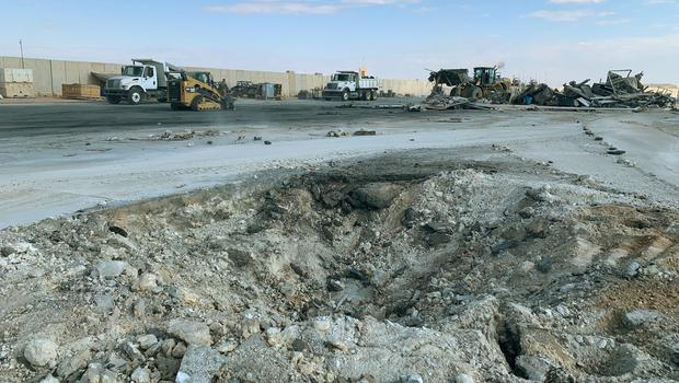 Iranian bombing caused a crater at Ain al-Asad air base in Anbar, Iraq (Ali Abdul Hassan/AP)