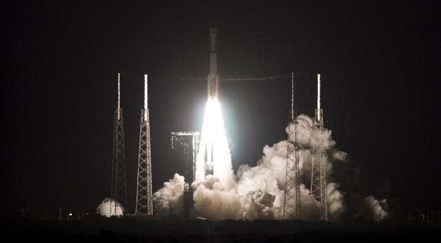 A United Launch Alliance Atlas V rocket with Boeing's CST-100 Starliner spacecraft launches from Space Launch Complex 41, Friday, Dec. 20, 2019, at Cape Canaveral Air Force Station in Florida. Boeing's new Starliner capsule rocketed toward the International Space Station on its first test flight Friday, a crucial dress rehearsal for next year's inaugural launch with astronauts.(Joel Kowsky/NASA via AP)