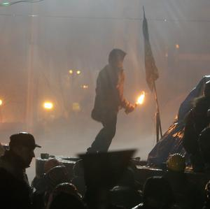 An anti-government protester prepares to throw a Molotov cocktail during clashes with riot police in Kiev's Independence Square (AP)