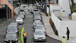 Cars line up at a food bank in Los Angeles (Marcio Jose Sanchez/AP)
