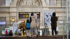 Health alerts at the main entrance of Bellevue Hospital, New York City. (AP)