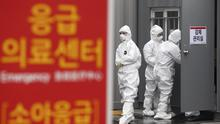 Officials wearing protective attire work to diagnose people with suspected symptoms of the new coronavirus at a hospital in Daegu, South Korea (AP)