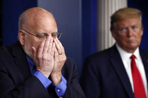 President Donald Trump watches as Dr. Robert Redfield, director of the Centers for Disease Control and Prevention, talks about face coverings at Wednesday's briefing (Alex Brandon/AP)
