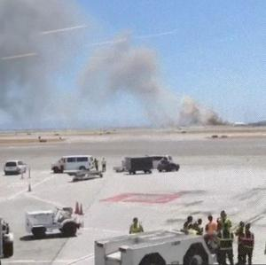 A cloud of smoke after an Asiana Airlines flight crashed while landing at San Francisco airport (Wei Yeh/AP)