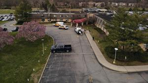 Ambulance crews are parked outside Andover Subacute and Rehabilitation Centre (Ted Shaffrey/AP)