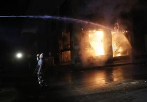 Police water cannon is used to douse a fire at a shop in Beirut (AP)