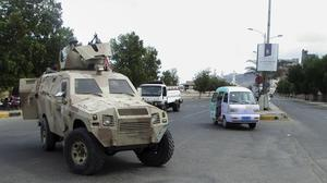 Militiamen loyal to president Abed Rabbo Mansour Hadi ride on an army vehicle as they patrol a street in Aden (AP)