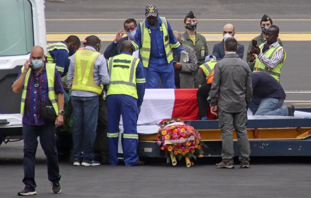 The coffins of the Italian ambassador and a military police officer, draped with the Italian flag, at an airport in DR Congo (Justin Kabumba/AP)