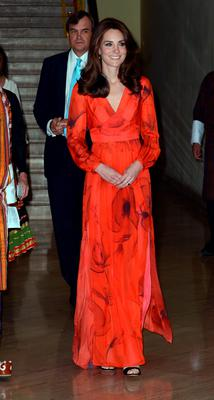 Kate at the reception in her £745 red chiffon gown made by Beulah, one of her favourite fashion houses