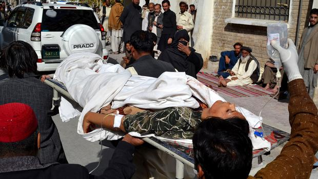 Pakistani volunteers carry an injured polio worker to a local hospital in Quetta after the attack (AP)