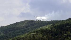 A Russian Emergency Ministry's Beriev plane BE-200 Be-200 multipurpose amphibious aircraft releasing water in the Trans-Baikal National Park in Buryatia, southern Siberia (AP)