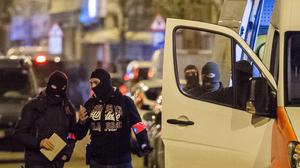 Police investigate an area where terror suspect Mohamed Abrini was arrested in Brussels (AP)