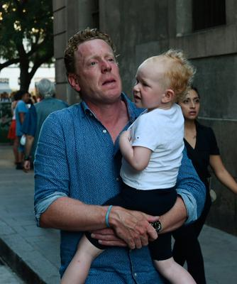 A frightened father flees with his young child