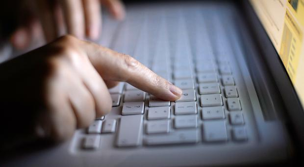 Generic stock photo shows hands using a laptop keyboard (Dominic Lipinski/PA)