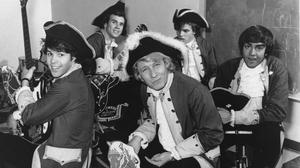 Paul Revere, front, the organist and leader of the Raiders rock band, has died aged 76 (AP)