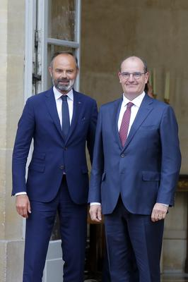 Outgoing French prime minister Edouard Philippe, left, and newly appointed premier Jean Castex pose before the handover ceremony (Michel Euler/AP)