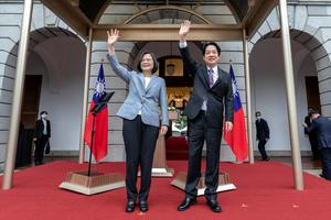 President Tsai Ing-wen, center left, waves with Vice President Lai Ching-te after their inauguration ceremony (Taiwan Presidential Office via AP)