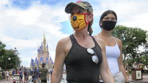 Florida hit a grim milestone on Sunday as it broke the national record for a state's largest single-day increase in positive cases (Joe Burbank/Orlando Sentinel/AP)
